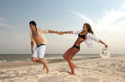 Boy and girl running on beach. Young boy and girl running on beach Stock Photos
