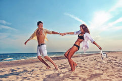 Boy and girl running on beach. Young boy and girl running on beach Royalty Free Stock Image