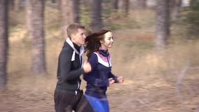 Boy and girl running on a forest path. stock video