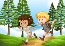 Boy and girl running in the park Stock Images