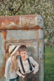 A boy with a girl at the rusty door Stock Images