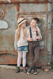 A boy with a girl at the rusty door Royalty Free Stock Image