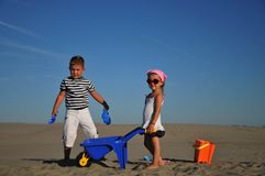 Boy and girl on the sand. Happiness Stock Photography