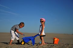 Boy and girl on the sand. Happiness Royalty Free Stock Images
