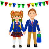 Boy and girl in a school uniform holding hand. Royalty Free Stock Image