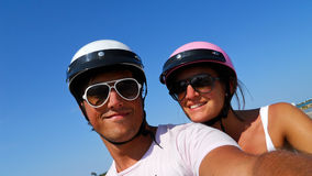 Boy and girl on scooter Stock Images