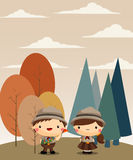 Boy and girl scout in forest background Royalty Free Stock Images