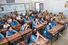 Boy and girl scout students sit in the classroom Royalty Free Stock Photography