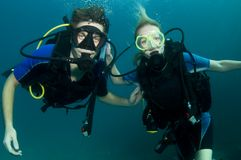 Boy and girl scuba dive together Royalty Free Stock Image