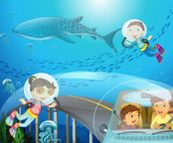 Boy and girl scuba diving under the ocean Royalty Free Stock Photo