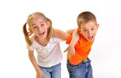 Boy and a girl scuffle Stock Images