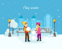 Boy and girl sculpt a snowman in  good mood. Stock Image