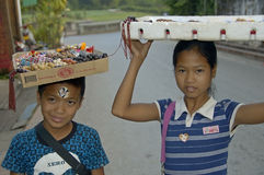 Boy and girl selling home made products, Laos Royalty Free Stock Image