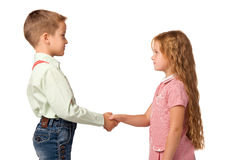 Boy and girl shaking hands with each other Royalty Free Stock Image