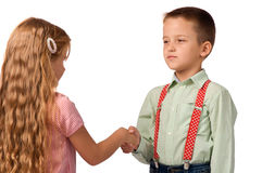 Boy and girl shaking hands with each other Stock Image