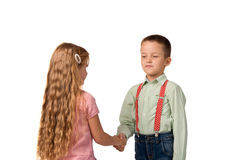 Boy and girl shaking hands with each other Stock Photography