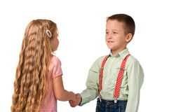 Boy and girl shaking hands with each other Royalty Free Stock Photography