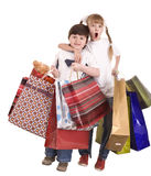 Boy and girl with shopping bag. Stock Photo