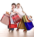 Boy and girl with shopping bag. Isolated Royalty Free Stock Photo
