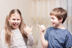 Boy and girl show each other Stock Photography