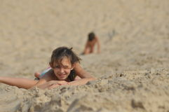 Boy and girl siblings in the dunes. The sand in the desert in the Slowinski National Park Stock Photo