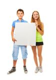 Boy and girl with sign. Couple of kids , boy and girl standing together with sign Stock Image