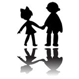 Boy and girl silhouettes Stock Image