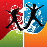 Boy and girl silhouettes jumping Stock Images