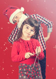 Boy and girl singing christmas carols. Christmas concept with brother and sister singing christmas carols stock photo