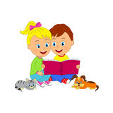 Boy and girl sit and read book Stock Photography