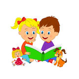 Boy and girl sit and read book Stock Image