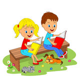 Boy and girl sitting on the bench and reading Stock Images