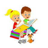 Boy and girl sitting on the book and reading Royalty Free Stock Images