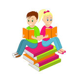 Boy and girl sitting on books and reading Royalty Free Stock Image