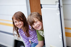 Boy And Girl Sitting At Caravan Entrance Royalty Free Stock Photos