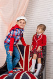 Boy with girl sitting on a chair Royalty Free Stock Photo