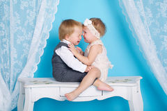 Boy with girl sitting and crying Royalty Free Stock Photos