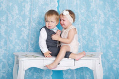 Boy with girl sitting and crying Stock Photos