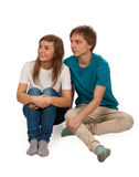 Boy and girl sitting on the floor Stock Images
