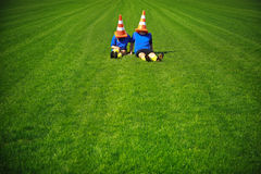 Boy and girl sitting on the football field Stock Image