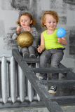 Boy and girl sitting on a ladder with balloons Royalty Free Stock Photography