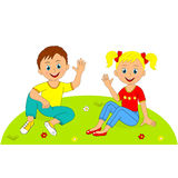 Boy and girl sitting in a meadow Royalty Free Stock Image