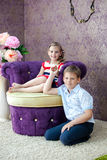 Boy and girl sitting in the nice room Royalty Free Stock Photos