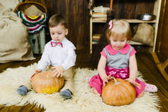 Boy and girl sitting with pumpkin Royalty Free Stock Photo