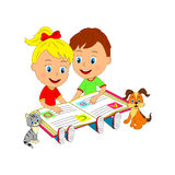 Boy and girl are sitting and reading a book Stock Images