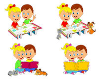 Boy and girl are sitting and reading a book Royalty Free Stock Photography