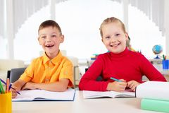 Boy and girl sitting together Royalty Free Stock Photography