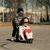Boy and girl skating on the street Stock Photo