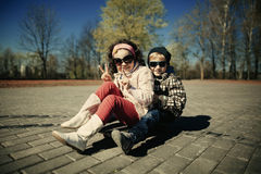 Boy and girl skating on the street Royalty Free Stock Photos