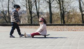 Boy and girl skating on the street Royalty Free Stock Images
